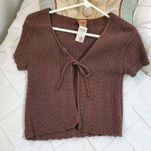 Woman's brown sweater shrug